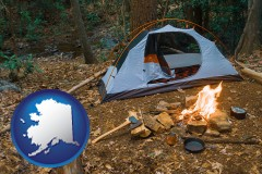 alaska map icon and camping tent at a wilderness campsite