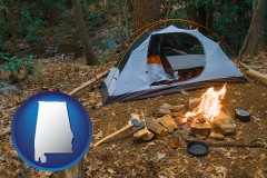 alabama map icon and camping tent at a wilderness campsite