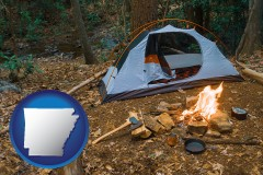 arkansas map icon and camping tent at a wilderness campsite