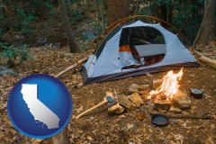 california map icon and camping tent at a wilderness campsite