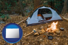 colorado map icon and camping tent at a wilderness campsite