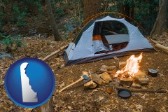 delaware map icon and camping tent at a wilderness campsite
