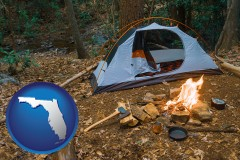 florida map icon and camping tent at a wilderness campsite