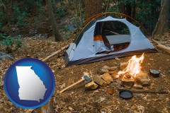georgia map icon and camping tent at a wilderness campsite