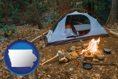 iowa map icon and camping tent at a wilderness campsite
