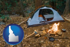 idaho map icon and camping tent at a wilderness campsite