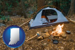 indiana map icon and camping tent at a wilderness campsite