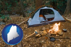 maine map icon and camping tent at a wilderness campsite