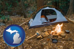 michigan map icon and camping tent at a wilderness campsite