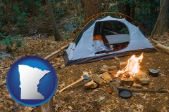 minnesota map icon and camping tent at a wilderness campsite