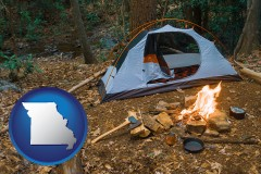 missouri map icon and camping tent at a wilderness campsite
