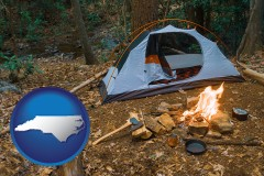 north-carolina map icon and camping tent at a wilderness campsite