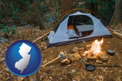new-jersey map icon and camping tent at a wilderness campsite