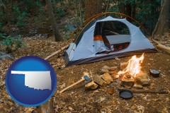 oklahoma map icon and camping tent at a wilderness campsite