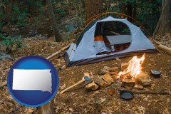 south-dakota map icon and camping tent at a wilderness campsite