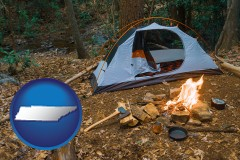 tennessee map icon and camping tent at a wilderness campsite