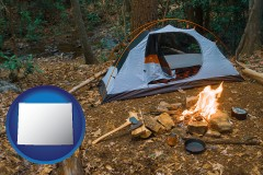 wyoming map icon and camping tent at a wilderness campsite