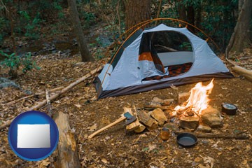 camping tent at a wilderness campsite - with Colorado icon