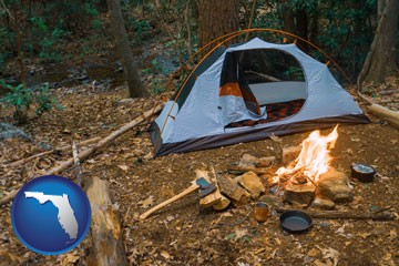 camping tent at a wilderness campsite - with Florida icon