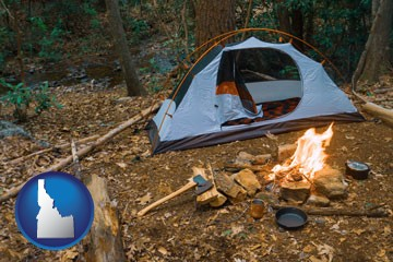 camping tent at a wilderness campsite - with Idaho icon