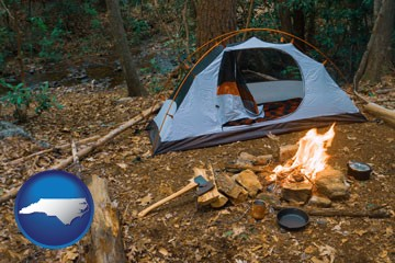 camping tent at a wilderness campsite - with North Carolina icon