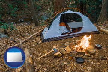 camping tent at a wilderness campsite - with North Dakota icon