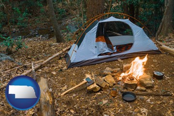 camping tent at a wilderness campsite - with Nebraska icon